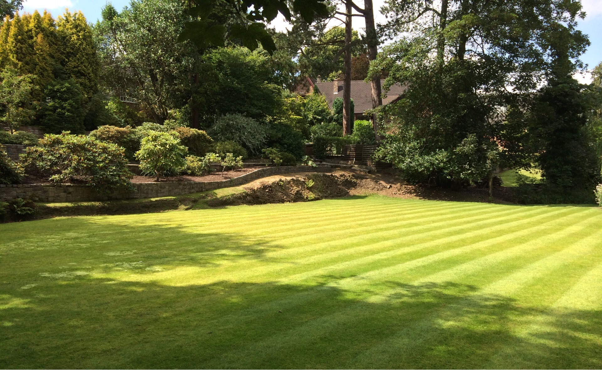 Landscape Gardener in Newcastle under Lyme - A Lawn left with the customary football pitch stripe