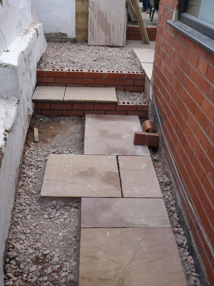 Laying the Indian stone path - Landscaping in Stoke-on-Trent