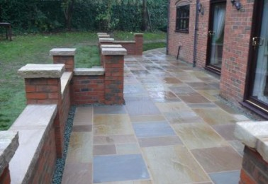 Red Brick Wall With Stone Capping
