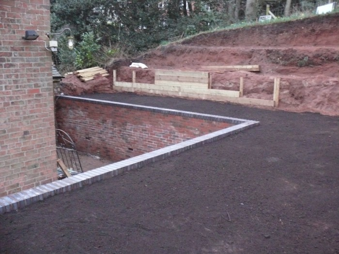 Brick wall and leveled top soil - Landscaping in Cheadle