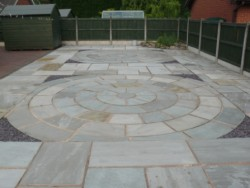Stone circle patio landscaping