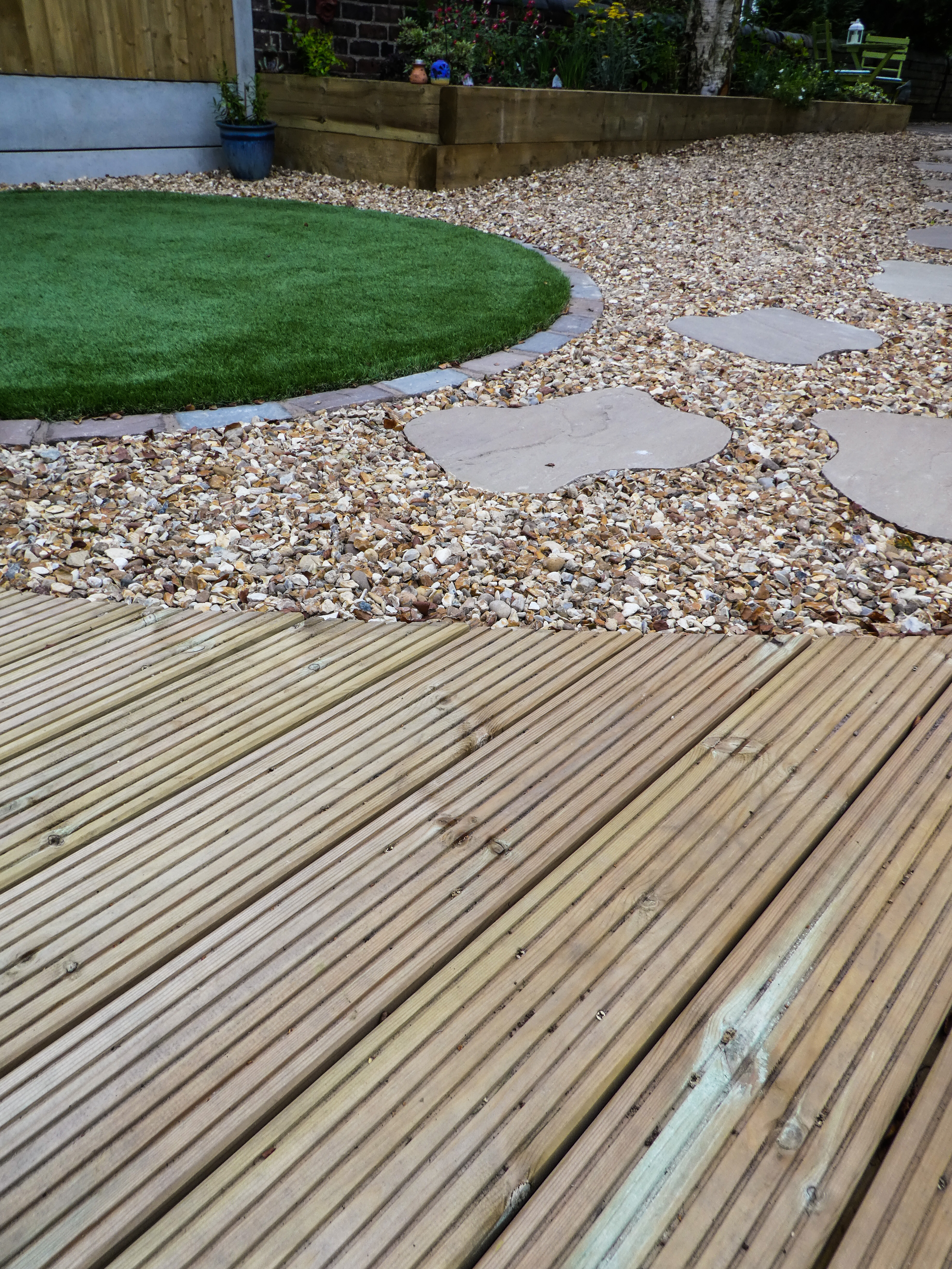 Landscape Gardener in Cheshire - Decking, Stepping Stone in Gravel area and turfing