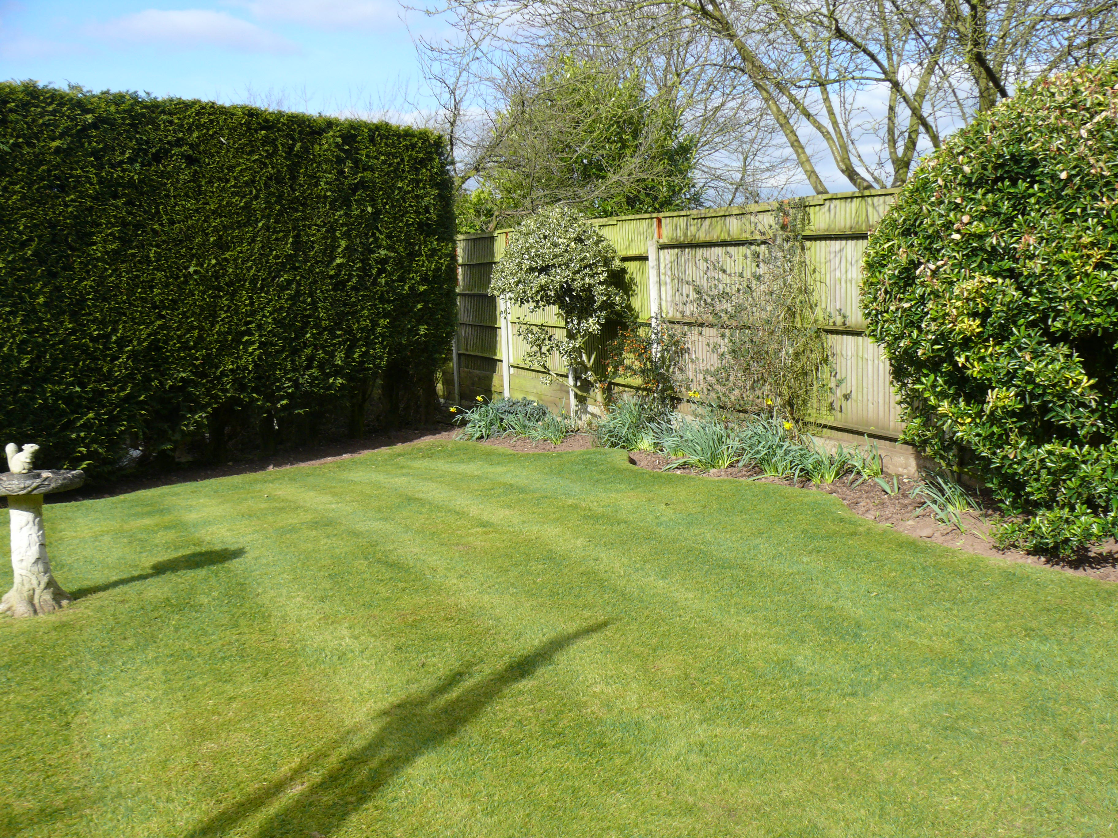 Garden Maintenance with lawns mowed and hedges cut