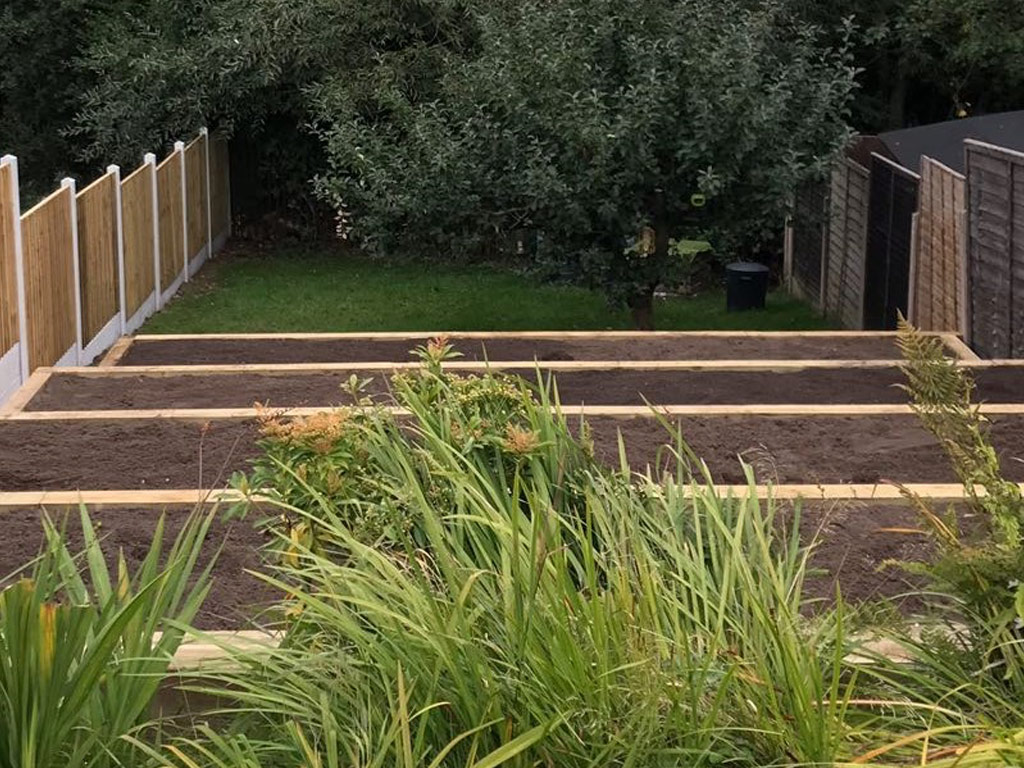 A photograph of decking provided by Blue Iris Landscapes for a steep garden in Stone, Staffordshire